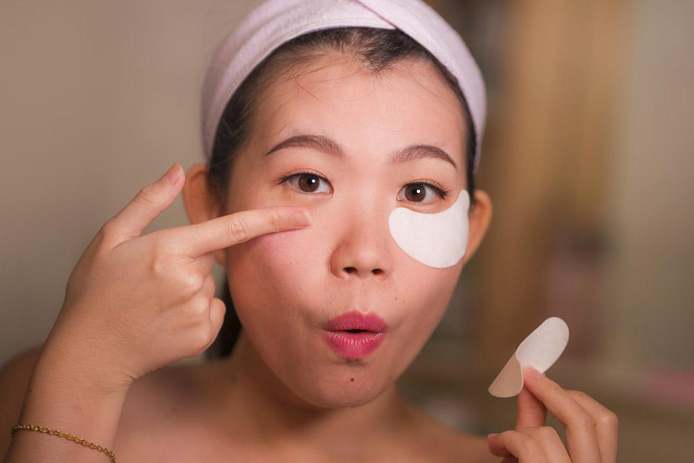 Applying hydrating eye patches